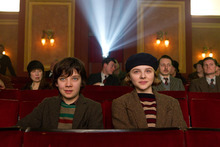 In this image released by Paramount Pictures, Asa Butterfield portrays Hugo Cabret, left, and Chloë Grace Moretz portrays  Isabelle in a scene from