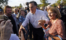 Republican presidential candidate, former Massachusetts Gov. Mitt Romney, greets residents as he campaigns in Lehigh Acres, Fla., Tuesday, Jan. 24, 2012. (AP Photo/Charles Dharapak)