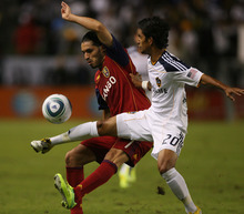 Kim Raff |  The Salt Lake Tribune Real Salt Lake player Fabian Espindola battles with LA Galaxy player A.J. DeLaGarza during the first half of the Western Conference Championship at The Home Depot Center in Carson, CA on Sunday, November 6, 2011.