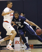 BYU's Brandon Davies (0) backs down Pepperdines's Taylor Darby, left, during the first half of an NCAA college basketball game, Saturday, Jan. 21, 2012, in Moraga, Calif. (AP Photo/Ringo H.W. Chiu)
