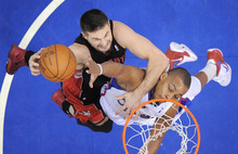 Toronto Raptors forward Linas Kleiza, left, of Lithuania goes up for a shot as Los Angeles Clippers guard Randy Foye defends during the second half of their game, Sunday, Jan 22, 2012, in Los Angeles.  (AP Photo/Reed Saxon)
