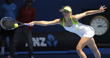 Maria Sharapova  of Russia hits a forehand return to compatriot Ekaterina Makarova during their quarterfinal at the Australian Open tennis championship, in Melbourne, Australia, Wednesday, Jan. 25, 2012. (AP Photo/Andrew Brownbill)