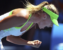 Maria Sharapova of Russia reacts after winning a point against compatriot Ekaterina Makarova in their quarterfinal at the Australian Open tennis championship, in Melbourne, Australia, Wednesday, Jan. 25, 2012.(AP Photo/Rick Rycroft)
