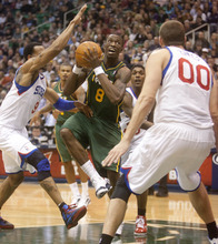 Jeremy Harmon  |  The Salt Lake Tribune  Utah's Josh Howard (8) tries to get a shot off as the Jazz face the 76ers at EnergySolutions Arena on Friday, December 30, 2011.