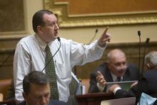 Al Hartmann  |  The Salt Lake Tribune John Dougall, R-Highland, speaks on  the floor of the House of Representatives Wednesday.