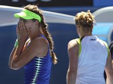 Victoria Azarenka of Belarus, left, celebrates after defeating Kim Clijsters of Belgium, right,  in their semifinal at the Australian Open tennis championship, in Melbourne, Australia, Thursday, Jan. 26, 2012.  (AP Photo/Rick Rycroft)