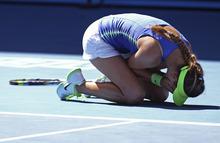 Victoria Azarenka of Belarus celebrates after defeating Kim Clijsters of Belgium during their semifinal at the Australian Open tennis championship, in Melbourne, Australia, Thursday, Jan. 26, 2012. (AP Photo/Rick Rycroft)