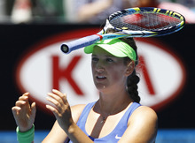 Victoria Azarenka of Belarus puts  a racket on her head after she lost a point to Kim Clijsters of Belgium during their semifinal at the Australian Open tennis championship, in Melbourne, Australia, Thursday, Jan. 26, 2012.(AP Photo/Aaron Favila)