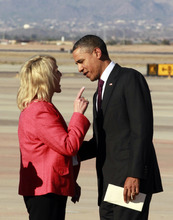 Arizona Gov. Jan Brewer points during an intense conversation with President Barack Obama after he arrived at Phoenix-Mesa Gateway Airport, Wednesday, Jan. 25, 2012, in Mesa, Ariz. Asked moments later what the conversation was about, Brewer, a Republican, said: