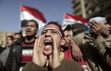 An Egyptian youth shouts slogans during a protest in Tahrir Square in Cairo, Egypt, Thursday, Jan. 26, 2012. Hundreds of thousands of Egyptians have marked the first anniversary of the uprising that toppled Hosni Mubarak with rallies in major squares across Egypt that turned into a show of strength by secular groups in their competition with the country's powerful Islamists over demands for an end to military rule. (AP Photo/Muhammed Muheisen)