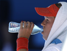 Caroline Wozniacki of Denmark takes a drink during a break as she plays Kim Clijsters of Belgium in their quarterfinal at the Australian Open tennis championship, in Melbourne, Australia, Tuesday, Jan. 24, 2012.(AP Photo/Sarah Ivey)