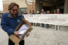 Leah Hogsten  |  The Salt Lake Tribune Tim Wagner of the Sierra Club shows the 200,000-plus signatures from all 50 states submitted online protesting the Alton coal mine's expansion. The Sierra Club handed over the papers to the Bureau of Land Management state headquarters and conducted an hourlong rally outside Thursday, Jan. 26, 2012.