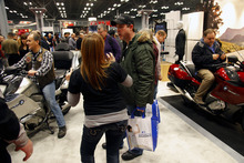 Motorcycle enthusiasts attend the opening of the Progressive International Motorcycle Show on Friday, Jan. 20, 2012 in New York.  The show highlights the latest from manufacturers and custom builders, and runs until Jan. 22.  (AP Photo/Bebeto Matthews)