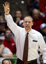 Utah Utes head coach Larry Krystkowiak signals his players against the Idaho State Bengals during the first half Friday, Dec. 16, 2011, in Salt Lake City, Utah. (© 2011 Douglas C. Pizac/Special to The Tribune)