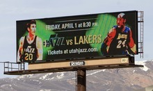Trent Nelson  |  Tribune File Photo An electronic billboard promoting a Jazz basketball game last April. Some legislators want the state -- not local communities -- ot have decision making-power over the new digital signs.