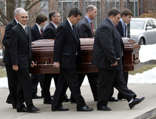 Pallbearers including sons Jay Paterno, foreground center, and Scott Paterno, foreground right, carry the casket with the remains of former Penn State coach Joe Paterno after funeral services at the Pasquerilla Spiritual Center on the Penn State campus, Wednesday, Jan. 25, 2012, in State College, Pa. Paterno died Sunday morning, Jan. 22. (AP Photo/Alex Brandon)