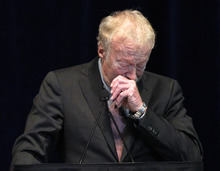 Phil Knight, former CEO and co-founder of  Nike, becomes emotional as he speaks during a memorial service for former Penn State football coach Joe Paterno at Penn State's Bryce Jordan Center in State College, Pa. Thursday Jan. 26, 2012.  A capacity crowd of more than 12,000 packed the Bryce Jordan Center for one more tribute to Paterno, the Hall of Fame football coach who died Sunday from lung cancer.  (AP Photo/Alex Brandon)