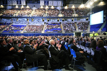 Members of the audience applaud at the conclusion of a video montage featuring moments from former Penn State head football coach Joe Paterno's career during a memorial service in Paterno's honor at Penn State's Bryce Jordan Center in State College, Pa., Thursday, Jan. 26, 2012. A capacity crowd of more than 12,000 packed Penn State's Bryce Jordan Center for one more tribute to Paterno, the Hall of Fame football coach who died Sunday from lung cancer. (AP Photo/York Daily Record, Chris Dunn)  YORK DISPATCH OUT