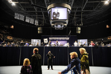 A member of the media, center, uses his phone as people enter for a memorial service for former Penn State football coach Joe Paterno at Penn State's Bryce Jordan Center in State College, Pa., Thursday, Jan. 26, 2012. A capacity crowd of more than 12,000 packed Penn State's Bryce Jordan Center for one more tribute to Paterno, the Hall of Fame football coach who died Sunday from lung cancer. (AP Photo/York Daily Record, Chris Dunn)  YORK DISPATCH OUT