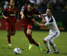 Kim Raff |  The Salt Lake Tribune Real Salt Lake player Fabian Espindola is held back by LA Galaxy player Todd Dunivant during the first half of the Western Conference Championship at The Home Depot Center in Carson, CA on Sunday, November 6, 2011.