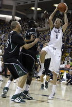 Utah State forward Ben Clifford (1) shoots against Hawaii's Trevor Wiseman, left, and Vander Joaquim, center, during the second half of an NCAA college basketball game, Thursday, Jan. 26, 2012, in Logan, Utah. Utah State won 77-72. (AP Photo/Jim Urquhart)