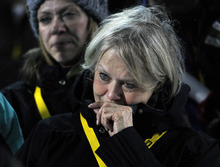 Jan Phelan, watches a montage honoring her late daughter, Sarah Burke, during a memorial at the Winter X Games in Aspen, Colo., on Thursday, Jan. 26, 2012. Burke died at the age of 29 following a training accident on a halfpipe in Utah. (AP Photo/The Denver Post, AAron Ontiveroz)