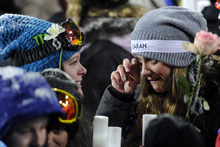 Skier Jess Cummings wipes a tear away during a memorial for the late Canadian skier Sarah Burke, at the Winter X Games in Aspen, Colo., on Thursday, Jan. 26, 2012. (AP Photo/The Denver Post, AAron Ontiveroz)