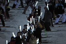 Athletes honor the late Canadian skier Sarah Burke during a memorial at the Winter X Games on Thursday, Jan. 26, 2012, in Aspen, Colo. (AP Photo/The Denver Post, AAron Ontiveroz)