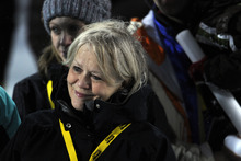 Sarah Burke's mother, Jan Phelan, watches a montage of her late daughter during a memorial at the Winter X Games in Aspen, Colo., on Thursday, Jan. 26, 2012. Burke was fatally injured in a training accident earlier this month. (AP Photo/The Denver Post, AAron Ontiveroz)