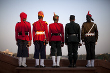 Indian military buglers wait on the ramparts of South Block before the final dress rehearsal for the Beating Retreat ceremony on Raisina Hill near the Presidential Palace in New Delhi, India, Friday, Jan. 27, 2012. The official ceremony on January 29th marks the end of Republic Day festivities. (AP Photo/Kevin Frayer)