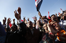 Egyptian protesters chant slogans at a rally to mark the first anniversary of the