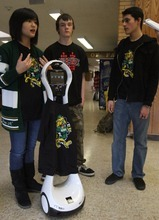 Rick Egan    The Salt Lake Tribune Kearns High School students, from left: Thao Nguyen, Zach Lester and Eric Mijanos, talk on Thursday about the robot they raised funds for. The Kearns High OK Club raised $3,500 toward the donation of a VGo robot to Primary Children's Medical Center. The robot is able to attend class for a patient, relaying video of class in real-time and asking questions for the patient.
