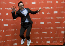 Kim Raff | The Salt Lake Tribune Actor Brian Berrebbi jumps in the air while posing for photographs on the red carpet before the premiere of