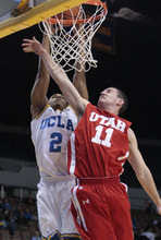 UCLA guard Kenny Jones (2) goes up for a basket as Utah's Alex Mortensen (11) defends in the second half of an NCAA college basketball game Thursday, Jan. 26, 2012, in Los Angeles. UCLA won 76-49. (AP Photo/Jason Redmond)