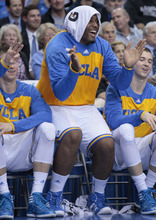 UCLA center Joshua Smith, center, celebrates from the bench in the second half of an NCAA college basketball game against Utah Thursday, Jan. 26, 2012, in Los Angeles. UCLA won 76-49. (AP Photo/Jason Redmond)