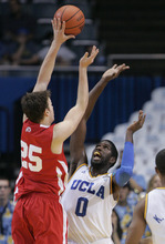 Utah forward Blake Wilkinson (25) shoots the ball as UCLA's Anthony Stover (0) defends in the second half of an NCAA college basketball game Thursday, Jan. 26, 2012, in Los Angeles. UCLA won 76-49. (AP Photo/Jason Redmond)