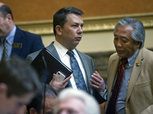 Al Hartmann  |  The Salt Lake Tribune Representative Stephen Sandstrom, left, confers with Representative Curtis Oda on the House of Representatives floor Friday January 27.