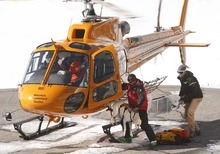 Leah Hogsten  |  The Salt Lake Tribune  Wasatch Powderbird helicopter brings back Wasatch Backcountry Rescuers rescuers out of the canyon where one skier died in an avalanche. One person died in an avalanche in the backcountry between Big and Little Cottonwood canyons late Saturday, January 28, 2012. A group of three people were skiing on Kessler Ridge, an area that drops down into Mineral Fork Canyon in Big Cottonwood Canyon, when the avalanche was triggered at about 11:30 a.m. Wasatch Backcountry Rescue and several other crews searched the area with dogs and were able to eventually locate the victim. Hoyal said the skier was found dead at the scene at about 12:45 p.m.