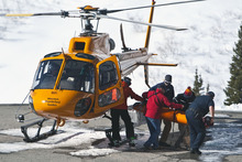Chris Detrick  |  The Salt Lake Tribune Rescuers carry out a body from a Wasatch Powderbird helicopter at Snowbird Saturday January 28, 2012. One person died in an avalanche in the backcountry between Big and Little Cottonwood canyons late Saturday morning. Unified Police Department Lt. Justin Hoyal said a group of three people were skiing on Kessler Ridge, an area that drops down into Mineral Fork Canyon in Big Cottonwood Canyon, when the avalanche was triggered at about 11:30 a.m.
