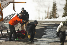Chris Detrick  |  The Salt Lake Tribune Two people involved in an avalanche get out of a Wasatch Powderbird helicopter at Snowbird Saturday January 28, 2012. One person died in an avalanche in the backcountry between Big and Little Cottonwood canyons late Saturday morning. Unified Police Department Lt. Justin Hoyal said a group of three people were skiing on Kessler Ridge, an area that drops down into Mineral Fork Canyon in Big Cottonwood Canyon, when the avalanche was triggered at about 11:30 a.m.