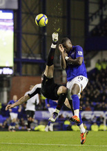 Everton's Magaye Gueye, right, vies for the ball against Fulham's Stephen Kelly during their FA Cup fourth round soccer match at Goodison Park, Liverpool, England, Friday Jan. 27, 2012. (AP Photo/Tim Hales)