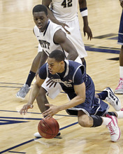 Georgetown's Markel Starks, bottom, loses the ball as he tries to get by Pittsburgh's Tray Woodall in the second half of the NCAA college basketball game on Saturday, Jan. 28, 2012, in Pittsburgh. Pittsburgh upset ninth ranked Georgetown 72-60.(AP Photo/Keith Srakocic)