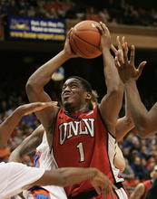 UNLV's Oscar Bellfield (0) drives past the defense of Boise State during the second half of an NCAA college basketball game on Wednesday, Jan. 25, 2012 in Boise, Idaho.  UNLV went on to win 77-72.  (AP Photo/Matt Cilley)