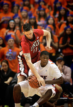 Boise State's Derrick Marks, bottom, goes after a loose ball against UNLV's Carlos Lopez (11) during the first half of an NCAA college basketball game on Wednesday, Jan. 25, 2012 in Boise, Idaho. (AP Photo/Matt Cilley)
