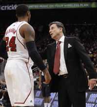Louisville coach Rick Pitino, right, gives instructions to Chane Behanan during the second half of an NCAA college basketball game against Villanova on Wednesday, Jan. 25, 2012, in Louisville, Ky.  Louisville defeated Villanova 84-74. (AP Photo/Timothy D. Easley)