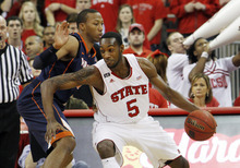 CORRECTS SPELLING OF VIRGINIA - North Carolina State forward C.J. Leslie (5) drives to the basket past Virginia's Akil Mitchell (25) during the first half of an NCAA college basketball game in Raleigh, N.C., Saturday, Jan. 28, 2012. (AP Photo/Jim R. Bounds)