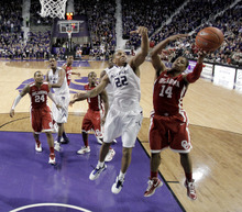 Oklahoma guard Carl Blair (14) beats Kansas State guard Rodney McGruder (22) to a rebound during the second half of an NCAA college basketball game on Saturday, Jan. 28, 2012, in Manhattan, Kan. Oklahoma won the game 63-60. (AP Photo/Charlie Riedel)