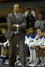 Eastern Illinois head coach Mike Miller walks the sidelines during action in the first half of an NCAA college basketball game against Murray State, Saturday, Jan. 28, 2012, in Murray, Ky. (AP Photo/Stephen Lance Dennee)