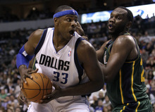 Dallas Mavericks' Brendan Haywood (33) attempts to get past Utah Jazz's Al Jefferson, right, in the first half of an NBA basketball game on Friday, Jan. 27, 2012, in Dallas. (AP Photo/Tony Gutierrez)
