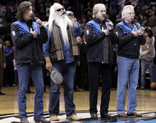 The Oak Ridge Boys, from left, Richard Sterban, William Lee Golden, Duane Allen and Joe Bonsall sing the national anthem before the start of an NBA basketball game between the Utah Jazz and Dallas Mavericks on Friday, Jan. 27, 2012, in Dallas. (AP Photo/Tony Gutierrez)